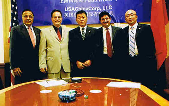 With Mayor and Governor of Shanghai and host - invited guest at MOU signing to establish new international medical research zone in China - 2006